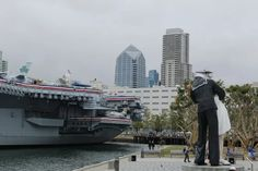 """San Diego is a big military town and has several monuments and memorials to fallen heroes and service people.  Here you'll see the sailor kissing the nurse (""""Unconditional Surrender"""") near the floating aircraft carrier museum, the USS Midway, near Harbor Drive.  A must-see if you are ever in San Diego. (Photo credit: San Diego video producer Patty Mooney of Crystal Pyramid Productions)  #crystalpyramidproductions   #ussmidway"""