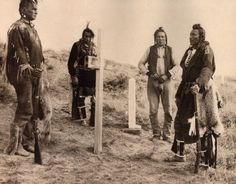 "Four of Lt. Col. George A. Custer's six Crow scouts pose for a photograph in 1908 standing among the tombstones on the Little Bighorn battlefield in this photograph from Herman J. Viola's book, ""Little Bighorn Remembered, the Untold Indian Story of Custer's Last Stand."" The four scouts are, from left, Whiteman Runs Him, Hairy Moccasin, Curley and Goes Ahead"