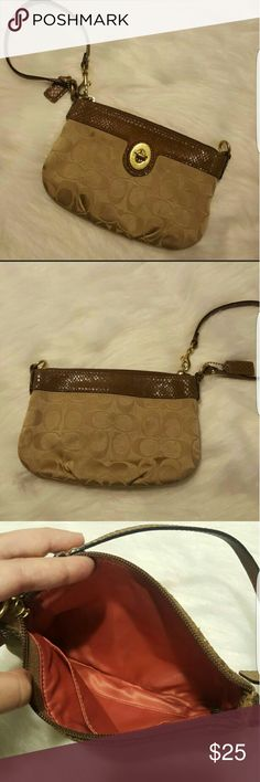 COACH WRISTLET BROWN TAN GOLD PREOWNED COACH WRISTLET IN VERY GOOD CONDITION HAS MINOR STAINS THAT MAY BE REMOVED  METAL ACCENTS HAVE A MINOR SCUFFS PLEASE SEE PICTURE  AUTHENTICATED WITH YKK ZIPPER Coach Bags Clutches & Wristlets