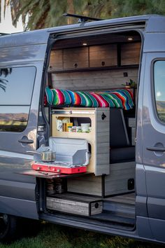 camper, camping The side slide-out storage locks in place in both positions and has a fold down tabl Vw Lt Camper, Sprinter Camper, Van Conversion Interior, Camper Van Conversion Diy, Camping Table, Van Camping, Camping Hacks, Iveco Daily 4x4, Motorhome