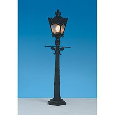 Capture the city streets with this Mini City Street Light. This electric lamp post is 1 feet 10 inches high and holds a small light bulb. Stumpsparty.com