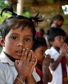UNDER THREAT:  Young Hindu children pray at a temple in Dambulla, Sri Lanka. Officials have decided to demolish a mosque and the Hindu temple under pressure from Buddhist monks who want their removal from a Buddhist sacred area.