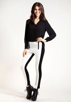 This is a must-have slimming outfit every woman should own thanks to its super chic black and white skinny leggings.