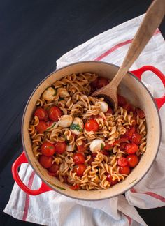 Easy Caprese pasta. Cook cherry tomatoes with olive oil for a few minutes and they create their own pasta sauce.