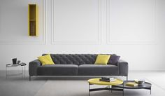 divano boston con schianale capitonè tavolo abaco giallo e fumo fatto in italia da pianca
