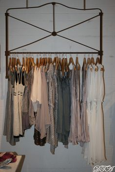 headboard clothing rack.  Could we use salvage to make some cool-looking free standing racks?
