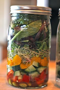 Asian Salad Jar  Dressing: Annie's shiitake sesame vinaigrette  Shredded carrots  diced cucumbers  sprouts  red bell pepper, diced  mandarin oranges (patted dry)  edamame  mixed baby greens  sesame seeds