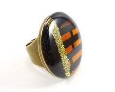 #kitokodesign#jewellery  Collection Ethnic Ultra Chic- Ring with wax print fabric and glitters. WWW.KITOKODESIGN.COM
