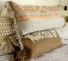 White and Gold Boho Tassels pillows 2 left by JaniceMcCartyDesign