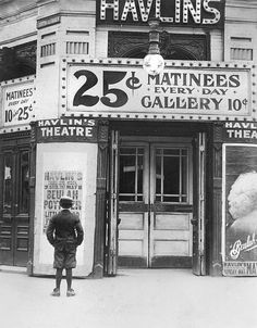 Boy In Front Of A Movie Theater Showing Canvas Print / Canvas Art by Everett