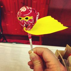 Take a normal lollipop and than add a cape and draw on a little mask and you have a superhero lollipop (if you want to make a certain superhero, use the color of the superhero and add other items that are similar to the superhero)