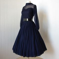 So cute vintage dress .beautiful navy silk chiffon full skirt bombshell dress with pintucked nude illusion bodice and billowing sleeves from Vintage Outfits, Vintage 1950s Dresses, Retro Dress, 60s Dresses, Vintage Clothing, Retro Mode, Vintage Mode, 1950s Style, Corsage