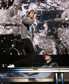 Alex Pall Photos Photos - Recording artists Andrew Taggart (L) and Alex Pall of The Chainsmokers perform onstage at WiLD 94.9's FM's Jingle Ball 2016 presented by Capital One at SAP Center on December 1, 2016 in San Jose, California. - WiLD 94.9's FM's Jingle Ball 2016 - Show