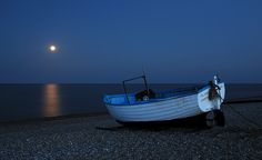 A peaceful and magical Moonrise over the sea in the coastal town of Dunwich in Suffolk; England.