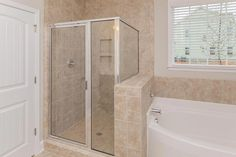 Owner's suite tiled standup shower with soaking tub in the Clark Craftsman KS