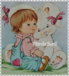 Bebê abraça coelhão