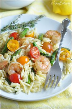 This spring salad with orzo, shrimp, and asparagus is filling, but light. Perfect for a potluck or dinner at home.