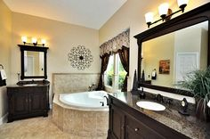 MASTER BATH SHOWING DOUBLE VANITIES AND CORNER TUB