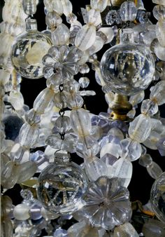 Rare Louis XIV Ormolu & Rock Crystal Chandelier DETAIL. French. The whole chandelier photo elsewhere on this board, There is a 3rd part too with an engraving showing about 6 of this very chandelier for a dinner in 1707 given by the Duke of Alba. Estimated value: $1,000,000 the pair.