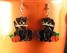 These fun earrings are bright orange pumpkins, perfect for Fall. The Pumpkins measure 1 high by 1 wide. The Pumpkins are made from coils of REAL paper. They are finished with an acrylic spray to increase durability. Quilling Earrings, Etsy Earrings, Acrylic Spray, Paper Frames, Ancient Art, Decorative Items, Etsy Seller, Pumpkins, Unique Jewelry