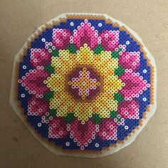 Perler flower. Adapted from cross stitch pattern ~