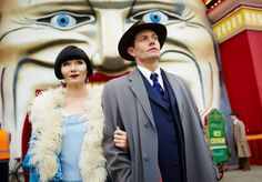 """""""Grab your coat, Miss Fisher. I believe I owe you a ride on the Great Scenic Railway."""" Miss Phryne Fisher (Essie Davis) and Detective Inspector Jack Robinson (Nathan Page)"""