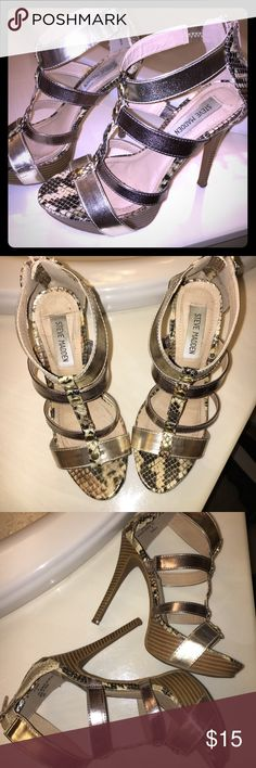 Steve Madden spiked sandals. 6.5 Gorgeous Steve madden gold bronze and snakeskin spiked sandals size 6.5 with 5 inch heel and 1 1/2 inch platform. Zip up heel and sexy cross straps. GUC Steve Madden Shoes Sandals