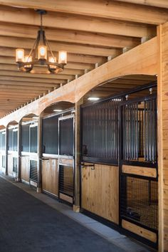 Careful planning brings on the best in this stunning barn. Tour the barn on Stable Style and learn about the thoughtful layout. Barn Stalls, Horse Stalls, Luxury Horse Barns, Modern Rustic Chandelier, Horse Barn Designs, Horse Shelter, Barn Loft, Dream Barn, Barn Plans
