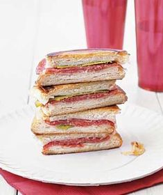 Salami Panini  4 burger or hot dog buns, split  4oz salami, thinly sliced  4oz fontina cheese, thinly sliced  2T unsalted butter or olive oil    1.Place bottoms of buns on work surface, cut-side up. Top w/ salami, fontina.   2. Put buns together.  Flatten slightly w/back of spatula. Spread top of each w  ½ T. butter.   3.Heat lg. skillet over med heat. Cook sandwiches, buttered-side down, pressing occasionally w/the back of  spatula, for 2 mins.   4.Flip & cook till cheese melts/bread is…
