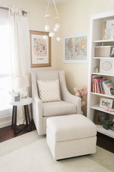 Modern glider in neutral nursery - gorgeous! Love the pop of gold in the pillow.