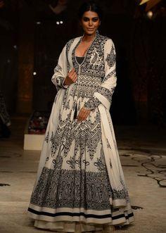 Model walks the ramp in  white embellished anarkali suit   for Rohit Bal at Indian Bridal Week 2013