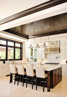 Beautiful Kitchen Like the combination of white cabinetry & dark wood on the island & ceiling. Dark framed windows!