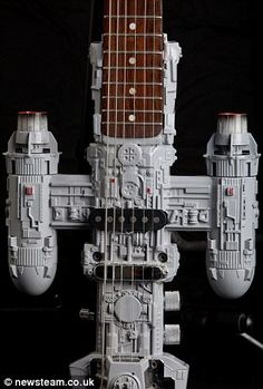 Millenium Full-strum: Tom's Millenium Falcon guitar took three months to make using a 140-piece kit of the famous Star Wars craft, while his Jedi Starfighter instrument uses a Hasbro Body, Westfield neck and Telecaster hardware