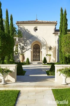 A Moorish arch frames the front door of the newly built house.