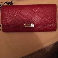 100% Authentic Burberry Wallet 100% Authentic Brand-new never been use: Burberry Porter' Check Embossed Leather Continental Wallet- Color Dark Plum: Snap-flap closure. Interior divided compartments; zip, slip and currency pockets; 12 card slots. Logo-jacquard lining. Leather. By Burberry; made in Italy. Designer Handbags: P.s Not a smoke free home. Burberry Bags Wallets