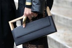 This structural wooden and leather clutch bag oozes with Bauhaus aesthetics #PFW street shot, Paris Fashion Week, spring/summer 2014