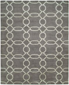 The Refraction transitional handmade rug is hand loomed in India from mountain wool and exquisite bamboo silk. Featuring a curvilinear design, inspired palette and sublime touch, this magnificent piece is suited to prominent spaces and comes in two color options. http://www.cyrusrugs.com/cyrus-artisan-item-7607&category_id=0