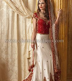 White raw silk classic bridal outfit with red top and a short train.