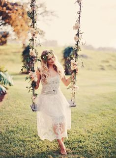 floral wedding swing with a bohemian style bridesmaid