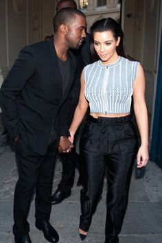 Pin for Later: Kim Kardashian and Kanye West Sure Have a Lot of Sweet Moments Together — See Them All!  Kanye whispered in Kim's ear while they visited Paris in July 2012.