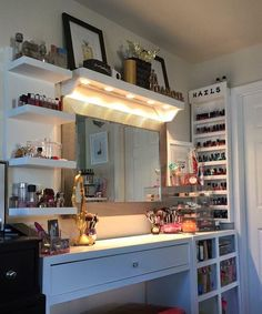 Vanity and makeup storage ideas. I like the lights shining down