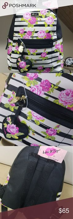 NWT-BETSEY JOHNSON BLACK&WHITE W/ROSE BACKPACK! NWT-BETSEY JOHNSON BLACK & WHITE STRIPED WITH ROSES BACKPACK! BEAUTIFUL BACKPACK WITH FLORAL DESIGN PLENTY OF ROOM FEATURES FRONT POCKET, INSIDE ZIPPER, BETSEY STRAPS ADJUSTABLE WITH HEART SHAPE PENDENT.  BRAND NEW WITH TAGS 100% AUTHENTIC SAME DAY SHIPPING NO TRADES OFFERS ACCEPTED THROUGH THE OFFER BUTTON  PLEASE FOLLOW CLOSET  RULES! I DO NOT TOLERATE RUDE BEHAVIOR IN MY BOUTIQUE PLEASE BE RESPECTFUL! Betsey Johnson Bags Backpacks