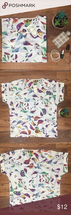 "Colorful bird print loose shirt Adorable bird print top adds interest and a pop of color! Chest measures 22.5"" armpit to armpit. Remember to bundle and save or make me an offer I accept most offers. Tops Blouses"