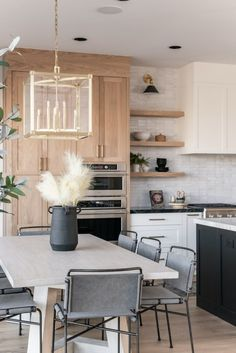 This breathtaking open-concept kitchen and dining space features our Forsyth pendant over the dining table, and Metal sconces over the… Boho Kitchen, New Kitchen, Kitchen Dining, Kitchen Decor, Dining Room, Dining Table, Kitchen Ideas, Hudson Valley, Open Concept Kitchen