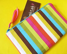 Rainbow stripes zipper pouch by oktak on Etsy, $18.00    This makes me think of summer and beaches and makes me smile :)
