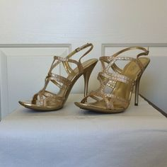 "Aldo Gold & Rhinestone Strappy Heels EUC.   Size 10-TTS.   4 3/4"" Heel.   1/2"" Platform.   Worn once!  Dress them up or down depending on your mood....  There is an adjustable buckle on the back strap which also has a small section of elastic for added comfort.  Soles reflect very minor wear. Comes in original box.                                                             (0003) ALDO Shoes Heels"