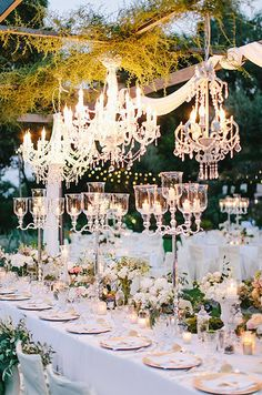 Whether an outdoor garden wedding or winter reception indoors, chandeliers instantly enhance a wedding theme's decor through color, grandeur and all the beautiful details in between.