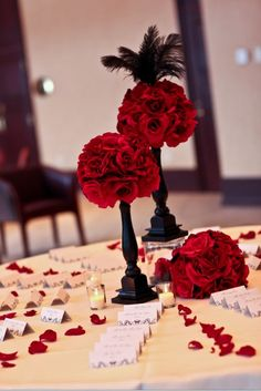 With pink flowers instead of red for my reception...so pretty. SO SIMPLE AND BEAUTIFUL!! Red rose pomander on a black candle stick... oh lord thats pretty.