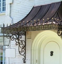 Photo of Potter Art Metal Studios - Dallas, TX, United States. Custom made, decorative antique copper awning with wrought iron scroll brackets. Awning Over Door, Porch Awning, Awning Canopy, Window Awnings, Door Canopy, Copper Awning, Metal Awning, Marquise, Eisen Pergola