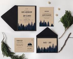 Forest Wedding Invitations:There's something so serene about the woods in winter. Particularly great for mountain or woodsy weddings, these simple forest invitations with a navy and black design feel like the peacefulness of a snowy evening. | 10 Ideas for Winter Wedding Invitations